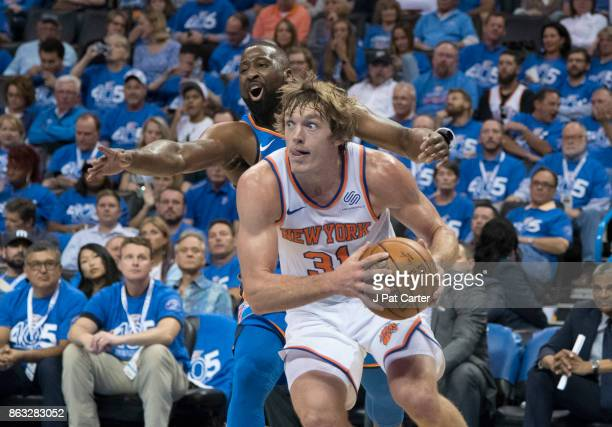 Ron Baker of the New York Knicks drives around Raymond Felton of the Oklahoma City Thunder during the second half of a NBA game at the Chesapeake...