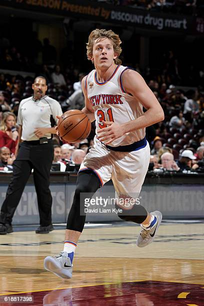 Ron Baker of the New York Knicks drives to the basket against the Cleveland Cavaliers on October 25 2016 at Quicken Loans Arena in Cleveland Ohio...