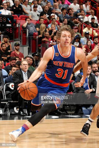 Ron Baker of the New York Knicks drives to the basket during the game against the Miami Heat on March 31 2017 at AmericanAirlines Arena in Miami...