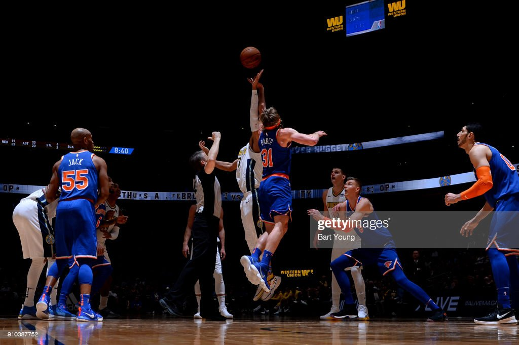 Ron Baker #31 of the New York Knicks goes for the jump ball against the Denver Nuggets on January 25, 2018 at the Pepsi Center in Denver, Colorado.
