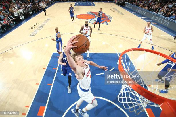 Ron Baker of the New York Knicks goes up for a dunk against the Philadelphia 76ers on April 12 2017 at Madison Square Garden in New York City New...