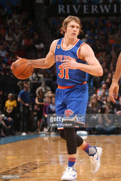Ron Baker of the New York Knicks handles the ball during a game against the Oklahoma City Thunder on February 15 2017 at Chesapeake Energy Arena in...