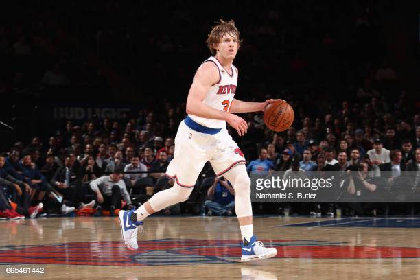 Ron Baker of the New York Knicks handles the ball during a game against the Washington Wizards on April 6 2017 at Madison Square Garden in New York...