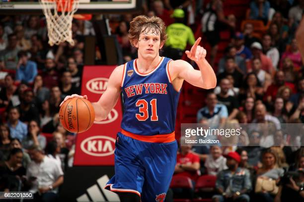 Ron Baker of the New York Knicks handles the ball during the game against the Miami Heat on March 31 2017 at AmericanAirlines Arena in Miami Florida...