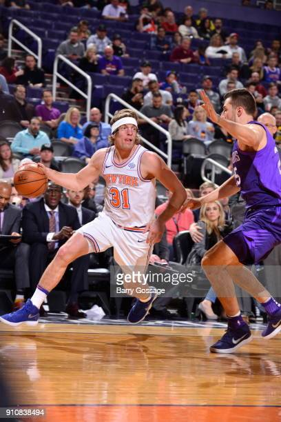 Ron Baker of the New York Knicks handles the ball during the game against the Phoenix Suns on January 26 2018 at Talking Stick Resort Arena in...