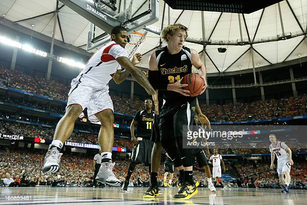 Ron Baker of the Wichita State Shockers controls the ball in the first half against Chane Behanan of the Louisville Cardinals during the 2013 NCAA...