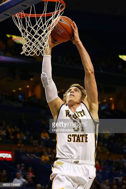 Ron Baker of the Wichita State Shockers dunk the ball against the Illinois State Redbirds during the MVC Basketball Tournament Semifinals at the...