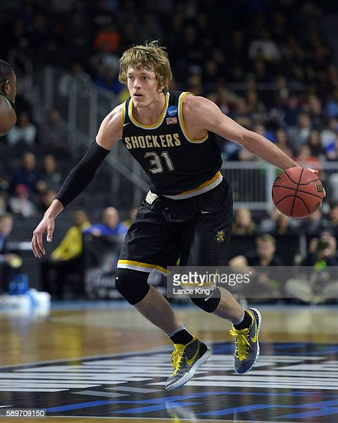 Ron Baker of the Wichita State Shockers moves the ball against the Miami Hurricanes during the second round of the 2016 NCAA Men's Basketball...