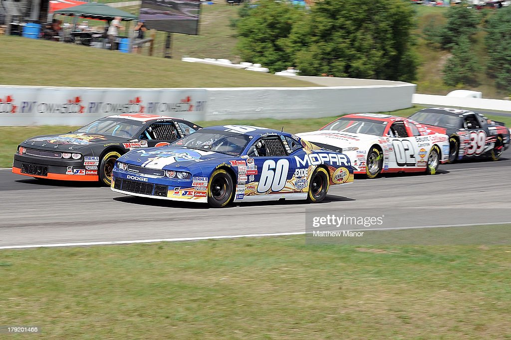 Ron Beauchamp Jr, Driver of the #60 Mopar/Exide/Pennzoil Dodge battles for track position during the NASCAR Canadian Tire Series presented by Mobil 1 Pinty's presents the Clarington 200 at Canadian Tire Motorsport Park on September 1, 2013 in Bowmanville, Canada.