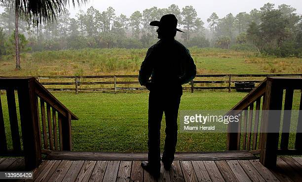 Ron Bergeron takes in the view from the cabin at his camp in Big Cypress Swamp in Florida on November 10 2011