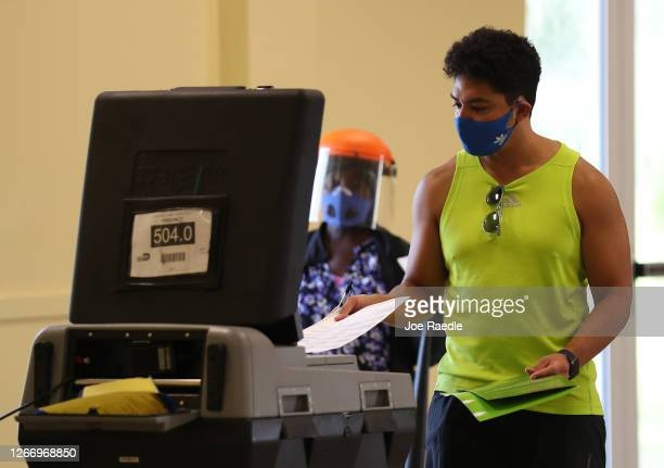 Ron Bilbao casts his vote on primary election day on August 18 2020 in Miami Florida Voters are casting ballots in MiamiDade to elect MiamiDade's...
