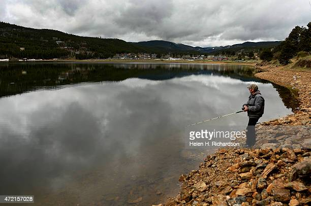 Ron Bills of Rollinsville takes advantage of the still but overcast weather to fish for trout in Barker Reservoir in Nederland Colorado on May 4 2015...