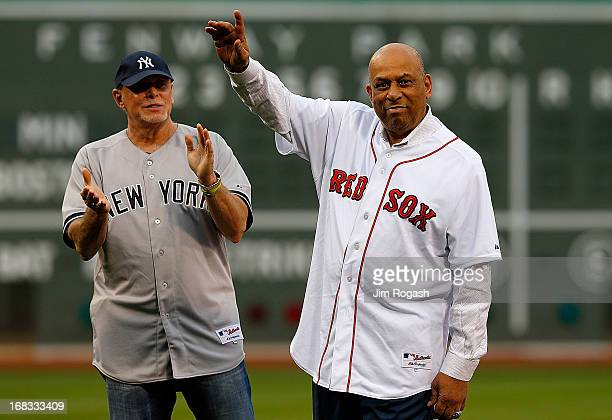 Ron Blomberg and Orlando Cepeda former designated hitters in Major League Baseball react during a pregame ceremony in their honor before a game...