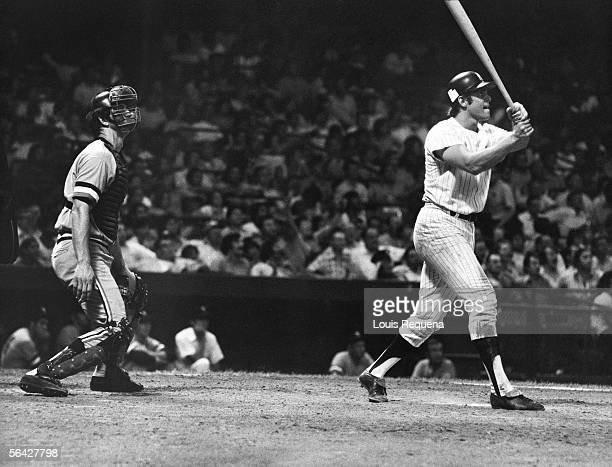 Ron Blomberg of the New York Yankees watches the ball leave the yard after hitting a home run against the Minnesota Twins during a game in July of...