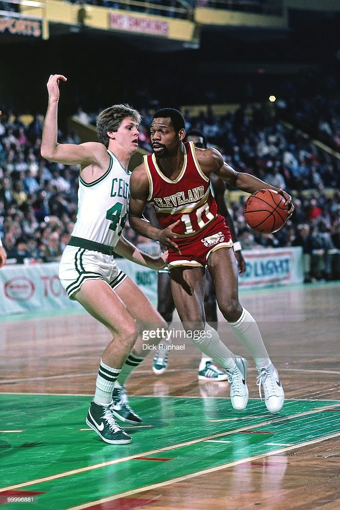Ron Brewer #10 of the Cleveland Cavaliers drives to the basket against Robert Parish #44 of the Boston Celtics during a game played in 1983 at the Boston Garden in Boston, Massachusetts.