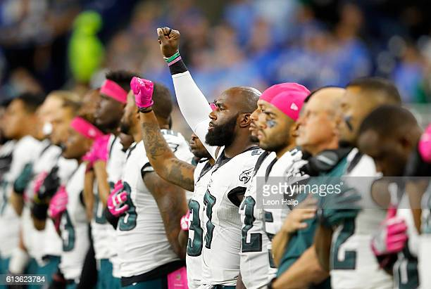 Ron Brooks of the Philadelphia Eagles and Malcolm Jenkins raise their fists during the National Anthem prior to the start of the game against the...