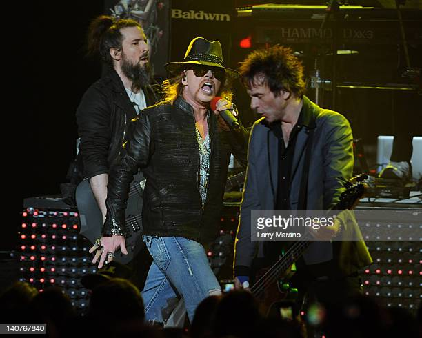 """Ron """"Bumblefoot"""" Thal, Axl Rose and Tommy Stinson of Guns N' Roses perform at Fillmore Miami Beach on March 5, 2012 in Miami Beach, Florida."""