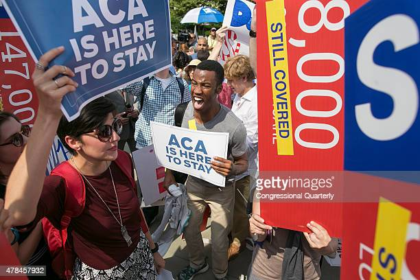 STATES JUNE 25 Ron Busby of Virginia center celebrates as the opinion for health care and the Affordable Care Act is reported outside of the Supreme...