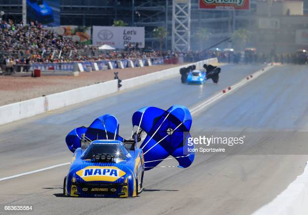 Ron Capps Don Schumacher Racing Dodge Charger NHRA Funny Car deploys a parachute during the NHRA DENSO Spark Plugs NHRA Nationals on April 01 2017 at...
