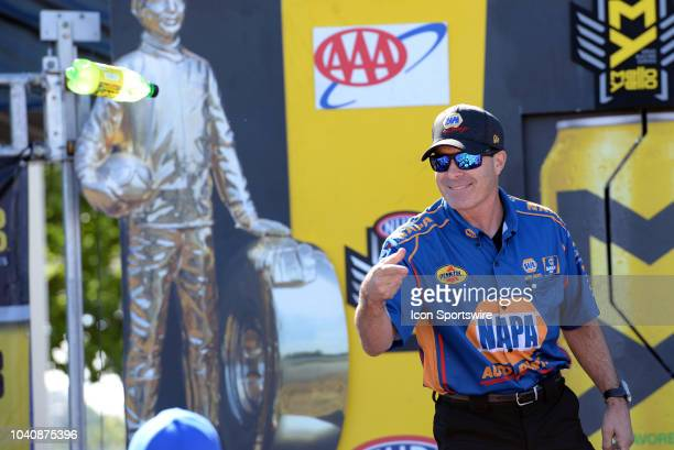 Ron Capps Don Schumacher Racing Dodge Charger NHRA Funny Car is introduced to the crowd during prerace festivities before the start of the NHRA AAA...