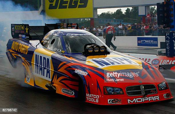 Ron Capps driver of the NAPA funny car does his burn out during qualifying for the NHRA Carolinas Nationals at the Zmax Dragway on September 12 2008...