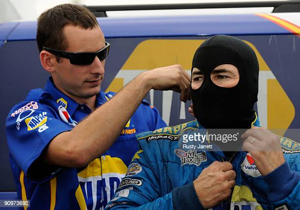 Ron Capps driver of the NAPA funny car prepares to drive during qualifying for the NHRA Carolinas Nationals on September 19 2009 at Zmax Dragway in...