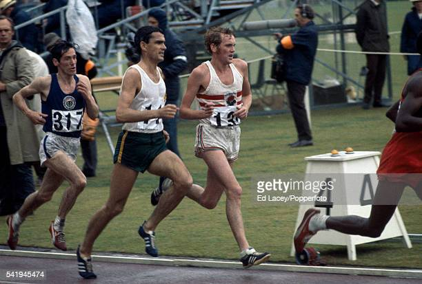 Ron Clarke of Australia and Dick Taylor of England lead Lachie Stewart of Scotland during the men's 10000 metres event during the British...
