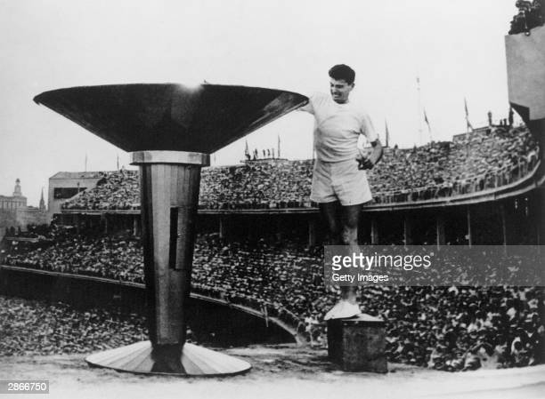 Ron Clarke of Australia lights the Olympic Torch at the opening ceremony of the 17th Olympic Games held in Melbourne during 1956.