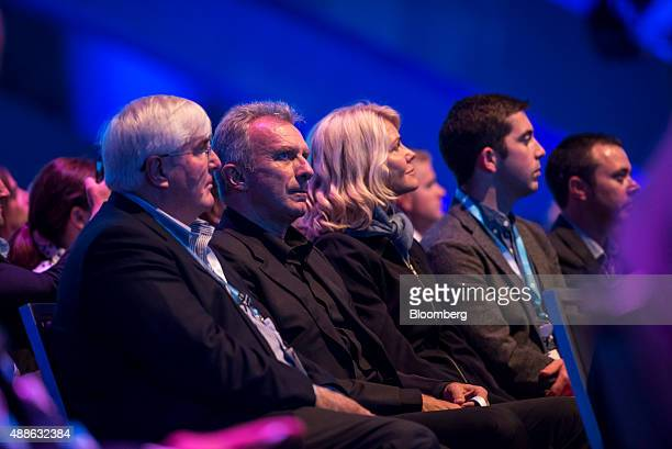 Ron Conway founder of SV Angel left and Joseph 'Joe' Montana cofounder of iMFL and retired National Football League quarterback watch a presentation...