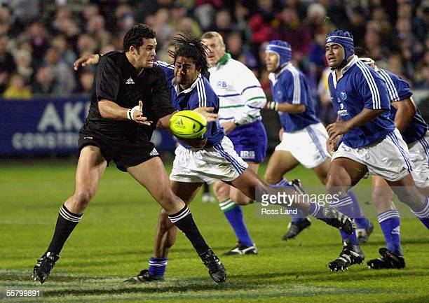 Ron Cribb looks for support as he is caught by Fereti Tuilagi during the All Blacks V Samoa rugby test at North Harbour Stadium Auckland Saturday The...