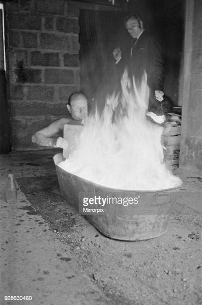 Ron Cunningham pictured in his bath ablaze Original caption says 'There's nothing like a hot bath on a cold March morning as Ron Cunningham...