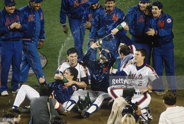 Ron Darling Rick Aguilera Bob Ojeda Howard Johnson and Kevin Elster of the New York Mets bring the celebration back to the crowd after defeating the...