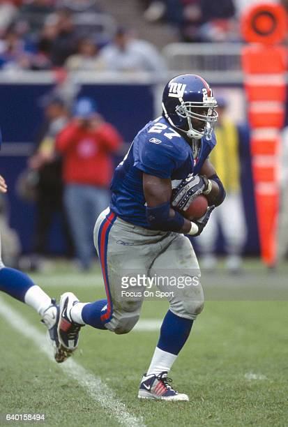 Ron Dayne of the New York Giants carries the ball against the New Orleans Saints during an NFL football game September 30 2001 at Giants Stadium in...