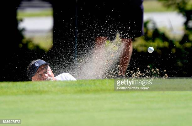 Ron Dery of Biddeford Saco CC chips out of a sand trap on the ninth hole during the Senior Amateur Golf Championship at the Falmouth Country Club...