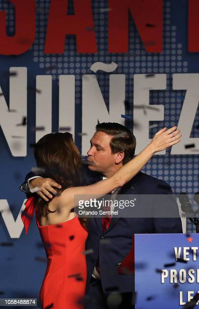 Ron DeSantis and his wife, Caey, celebrate after winning the Florida Governor's race during DeSantis' party at the Rosen Centre in Orlando, Fla., on...