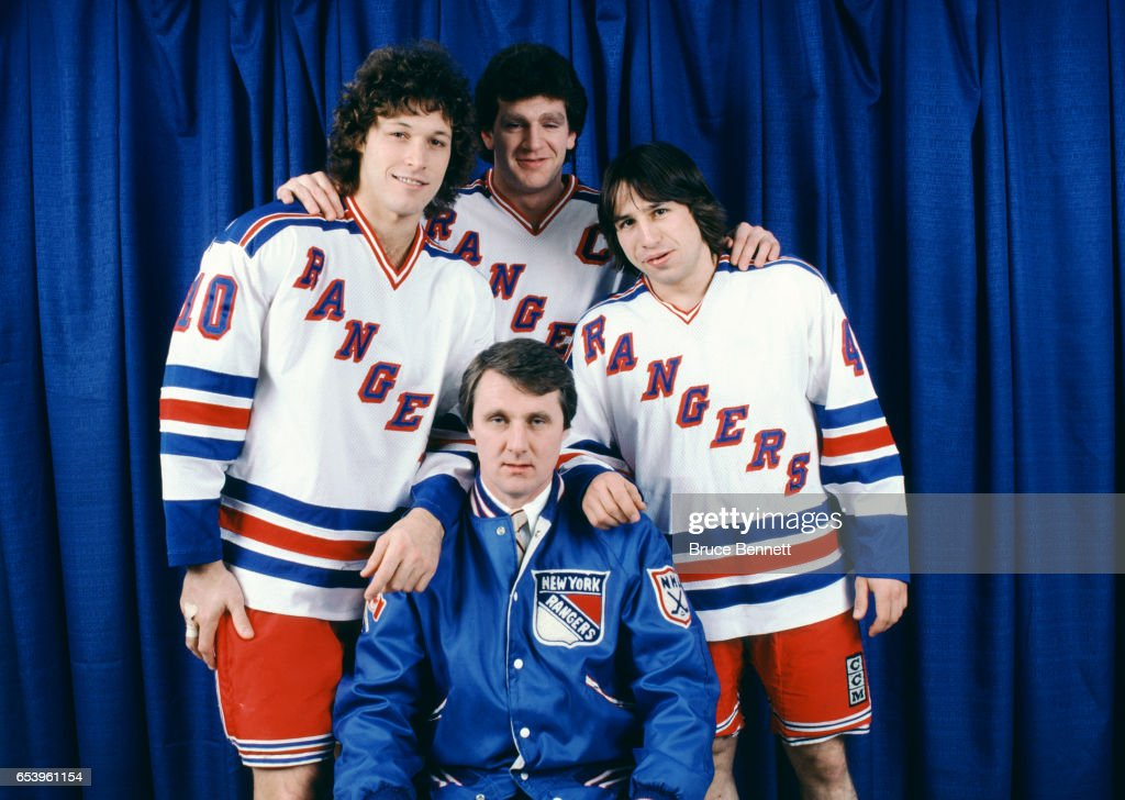 Ron Duguay #10, Barry Beck #3, Mark Pavelich #40 and head coach Herb Brooks pose for a portrait before an NHL game circa December, 1981 at the Madison Square Garden in New York, New York.