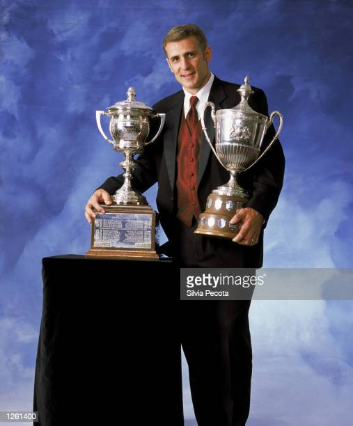 "Ron Francis of the Carolina Hurricanes poses for a studio portrait with the Lady Byng Memorial trophy for ""Sportmanship and Gentlemanly Conduct"" and..."