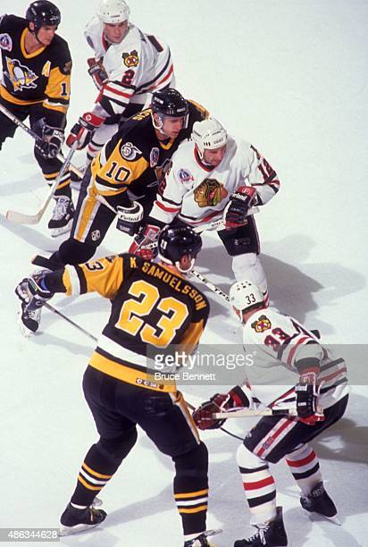 Ron Francis of the Pittsburgh Penguins and Brent Sutter of the Chicago Blackhawks take the face-off during Game 4 of the 1992 Stanley Cup Finals on...