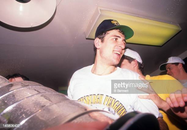 Ron Francis of the Pittsburgh Penguins celebrates in the locker room with the Stanley Cup after Game 4 of the 1992 Stanley Cup Finals against the...