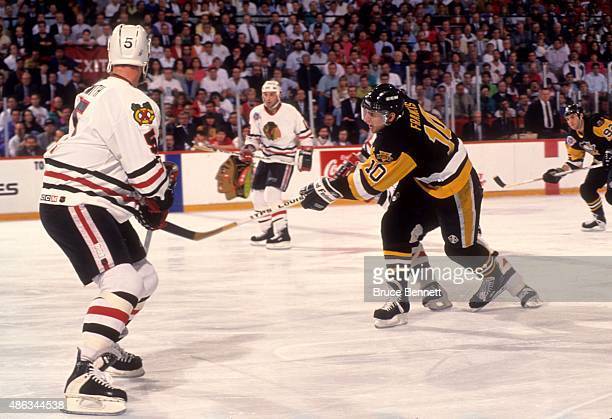 Ron Francis of the Pittsburgh Penguins dumps the puck into the offensive zone during Game 4 of the 1992 Stanley Cup Finals against the Chicago...