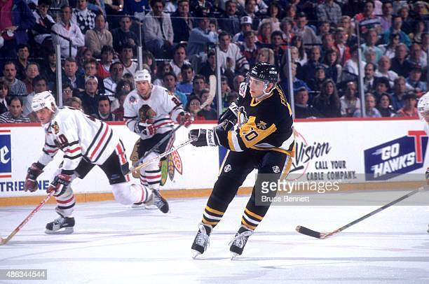 Ron Francis of the Pittsburgh Penguins passes the puck during Game 3 of the 1992 Stanley Cup Finals against the Chicago Blackhawks on May 30, 1992 at...