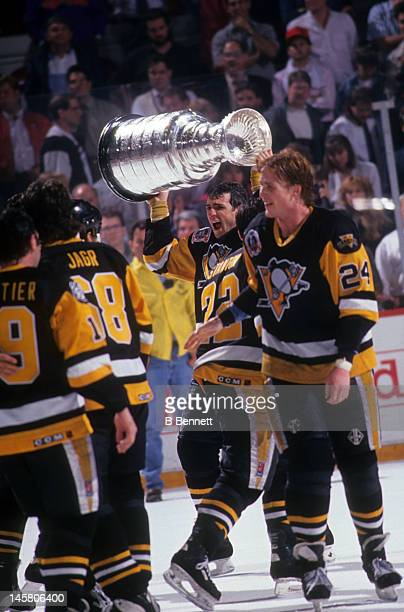 Ron Francis of the Pittsburgh Penguins skates on the ice with the Stanley Cup after Game 4 of the 1992 Stanley Cup Finals against the Chicago...