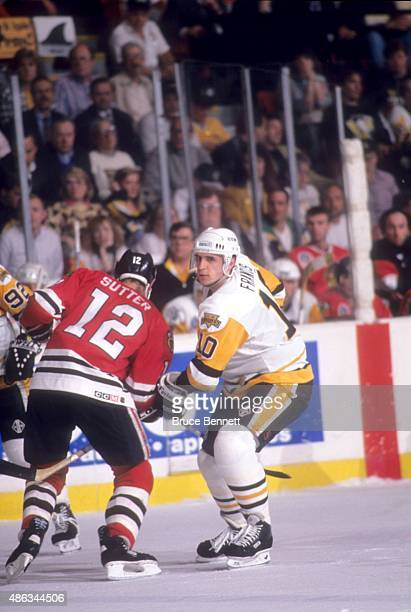 Ron Francis of the Pittsburgh Penguins tries to tie up Brent Sutter of the Chicago Blackhawks during Game 1 of the 1992 Stanley Cup Finals on May 26,...