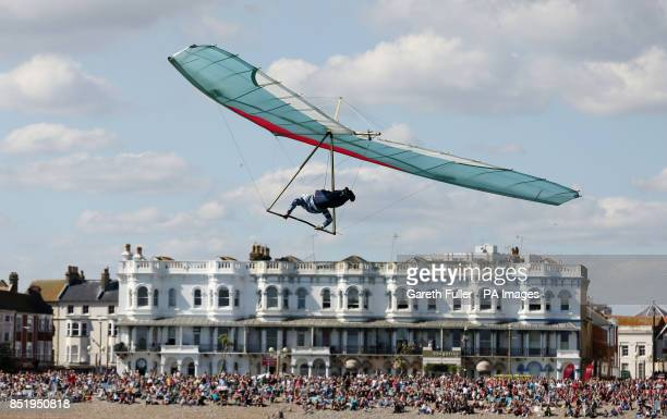 Ron Freeman glides from Worthing Pier in West Sussex during the Kingfisher class of the annual Worthing Birdman competition
