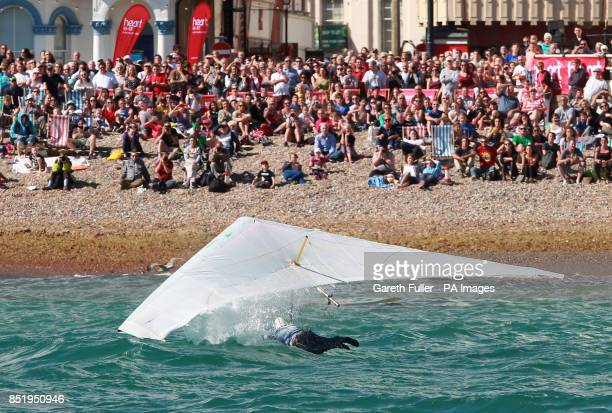 Ron Freeman glides into the sea from Worthing Pier in West Sussex during the Kingfisher class of the annual Worthing Birdman competition