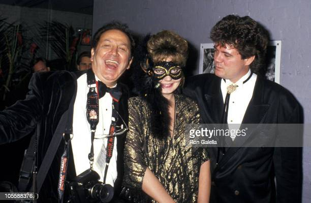 Ron Galella Maria Burton and Steve Carson during Ron Galella Photo Exhibition and Masked Ball October 28 1987 at Octagon Nightclub in New York City...