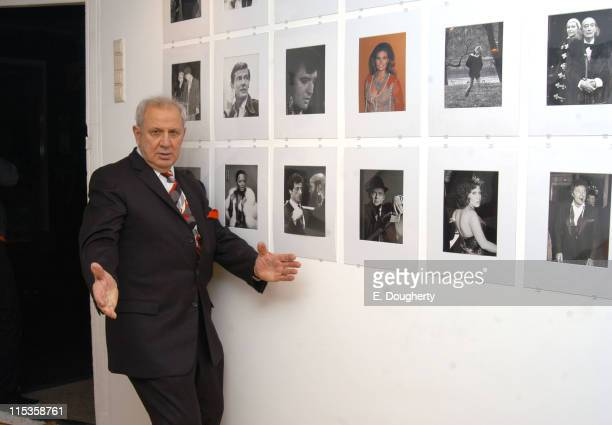 Ron Galella with some of his photos during Ron Galella Exhibit Photography with the Paparazzi Approach in Amsterdam at Gallery Wouter van Leeuwen in...