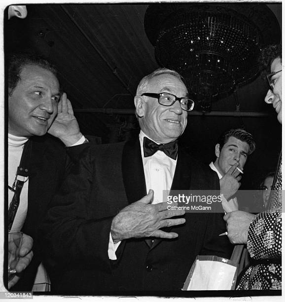 Ron Gallela and Malcolm Forbes at a Spy Magazine party on October 26 1988 in New York City New York