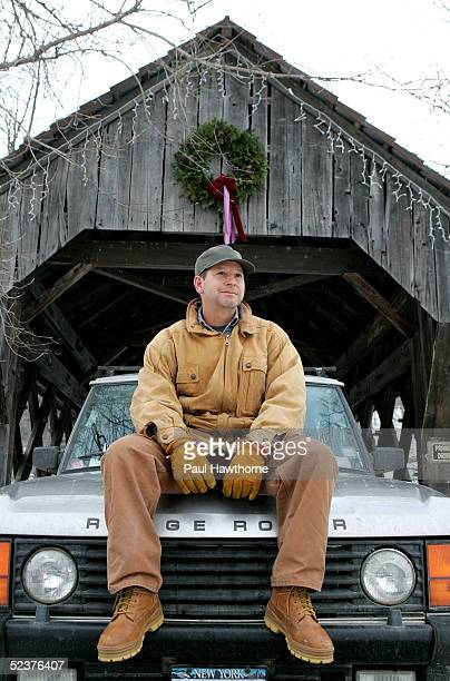Ron Galotti sits on his Range Rover in front of a covered bridge on the property of a friend January 19 2005 near North Pomfret Vermont