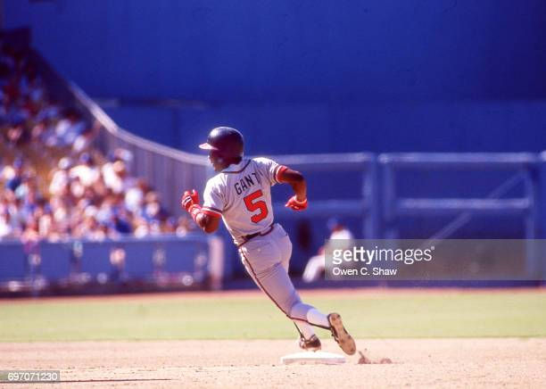 Ron Gant of the Atlanta Braves heads towards third against the Los Angeles Dodgers at Dodger Stadium circa 1987 in Los Angeles California